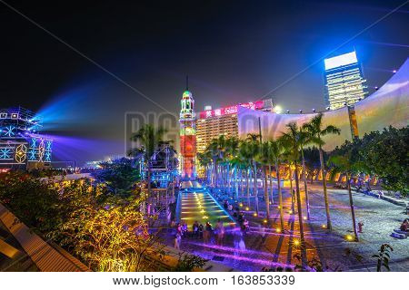 Hong Kong, China - December 5, 2016: the spectacular 3D light show at iconic buildings of Hong Kong Cultural Centre and Clock Tower. Victoria Harbour waterfront, Tsim Sha Tsui. Aerial view cityscape.