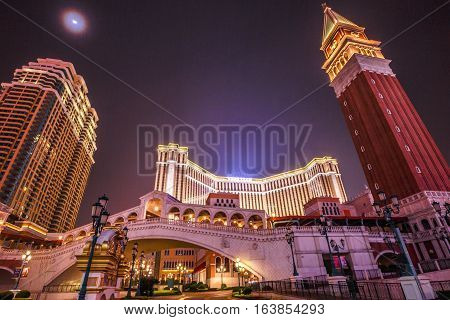 Macau, China - December 8, 2016: Cotai Strip at night: tower, bridge, shopping center, The Venetian and Four Seasons Hotel. Cotai Strip is a duty-free shopping paradise with almost 600 retail outlets.