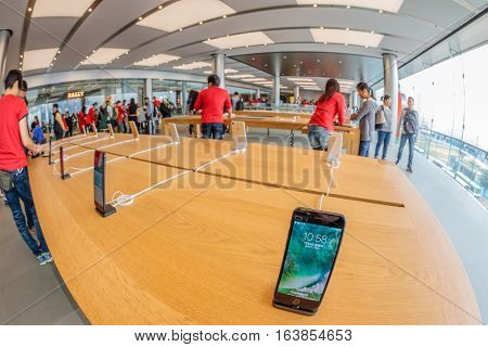 Hong Kong, China - December 4, 2016: interior of Apple store, IFC Mall, Central District. Apple is a multinational corporation that produces consumer electronics, computers, software. Fish-eye view.
