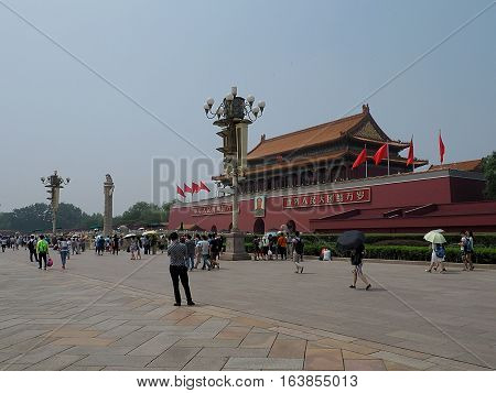 Tourists Square and the Mausoleum. Beijing, China - June 08, 2016 Tourists and residents of Beijing prior to the Mausoleum of Mao Zedong on Tiananmen Square in Beijing.