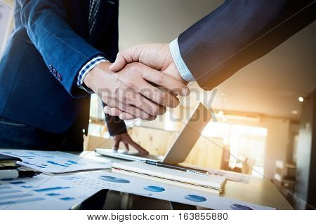 Businessmen shaking hands during a meeting project
