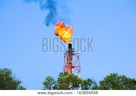 Burning oil gas flare.Flaring is the burning of natural gas that cannot be processed or sold.