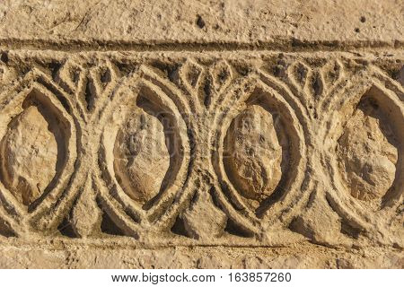 Bas-relief. stone architectural frieze with geometric patterns: abstract ornament.  Italy (Apulia).Detail of an architectural frieze of a drywall.