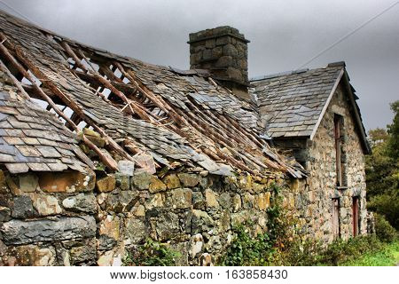 Old stone building with broken slate roof