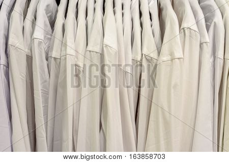 Vertical Rows Of White Mens Shirts