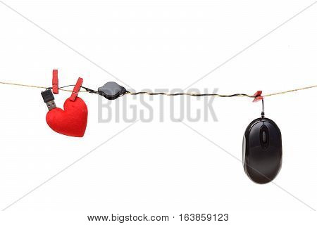 online dating - a computer mouse hung on the rope with a red heart