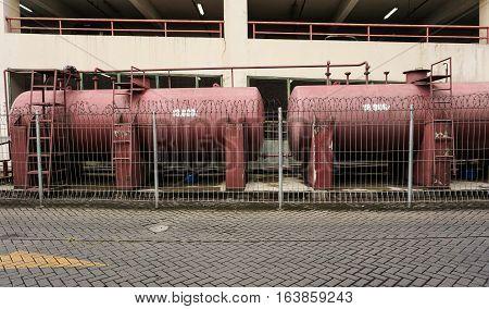 Water tank near parking lot photo taken in Semarang Indonesia java