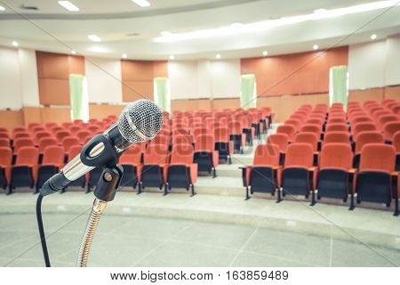 A Microphone in auditorium / lecture room