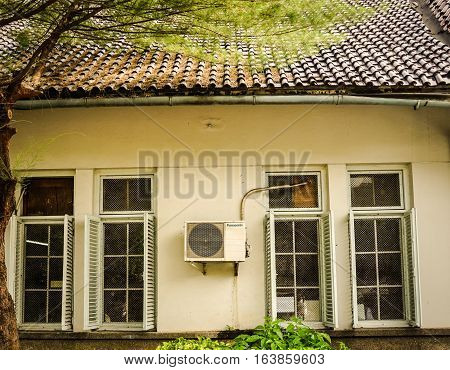 An empty house with two glass classic window photo taken in Semarang Indonesia java