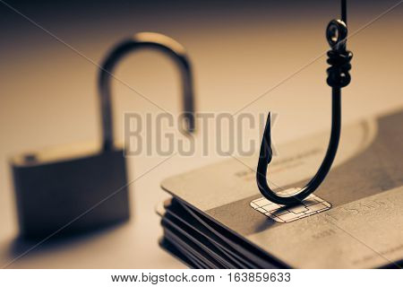 Credit card, a lock and a hook / credit card phishing attack