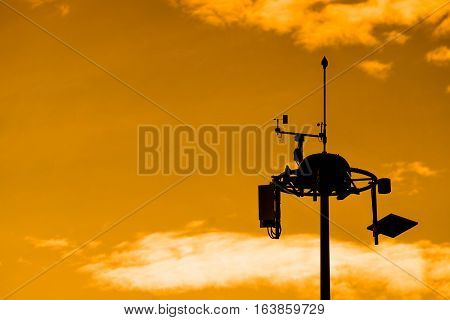 Silhouette of Weather measurement unit with blue sky background / Low Level Wind Shear Alert System : LLWAS