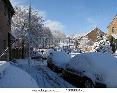 An urban village street covered in snow