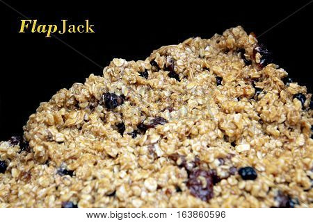 Fruit Flapjack Mix Ready To Bake In The Oven, Black Background With Copy Space For Text