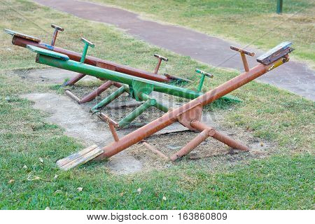 Old seesaw in outdoor playground for kids