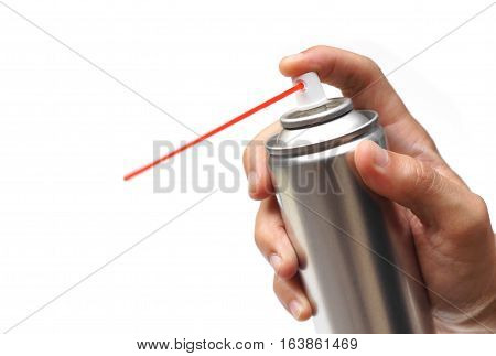 Hand holding a lubrication spray can isolated