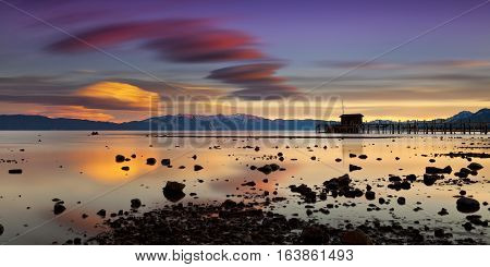 Pier in Tahoe City California in Lake Tahoe at sunset with vivid clouds