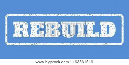White rubber seal stamp with Rebuild text. Vector tag inside rounded rectangular shape. Grunge design and dust texture for watermark labels. Horisontal sticker on a blue background.