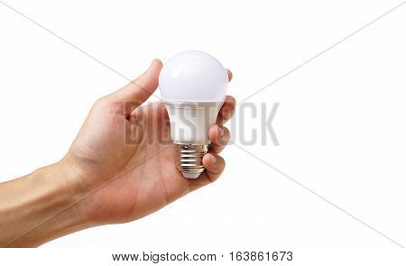 Hand holding a LED light bulb isolated  / Using economical and environmentally friendly light bulb concept