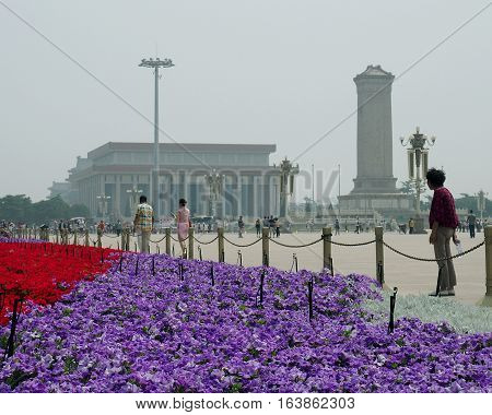 Flowers from the square in Beijing. Beijing, China - June 08, 2016 Lawn with colorful flowers on Tiananmen Square in Beijing.