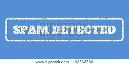 White rubber seal stamp with Spam Detected text. Vector message inside rounded rectangular banner. Grunge design and dirty texture for watermark labels. Horisontal sign on a blue background.