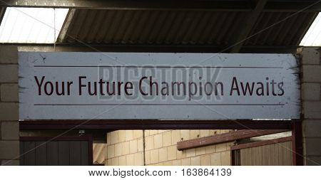 your future champion awaits sign over a doorway