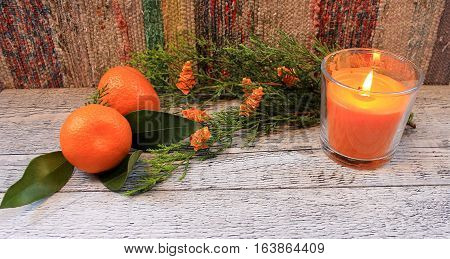 Beautiful New Year's and Christmas composition with tangerines, thuja and candle