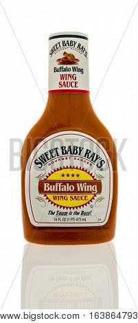 Winneconne WI - 2 January 2017: Bottle of Sweet Baby Ray's wing sauce on an isolated background.