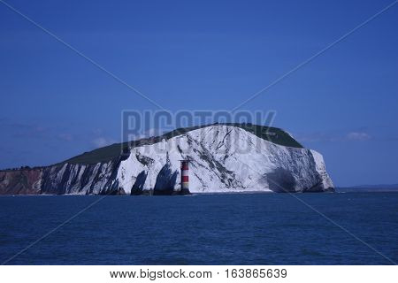 White Cliffs Towering Above A Blue Sea