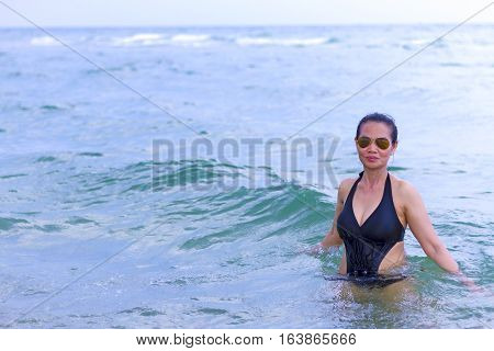 Lady on water in Ban Krut Beach at Prachuap Khirikhun Province Thailand
