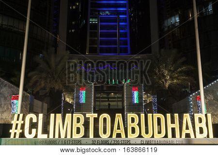 ABU DHABI UAE - NOV 25 2016: Climb to Abu Dhabi Vertical Marathon advertisementin front of the Etihad Towers in Abu Dhabi United Arab Emirates