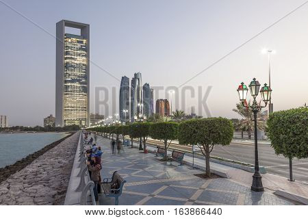 ABU DHABI UAE - NOV 26 2016: Corniche in the city of Abu Dhabi at dusk. United Arab Emirates Middle East
