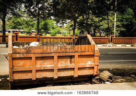 Abandoned garbage truck on the road side photo taken in Semarang Indonesia java