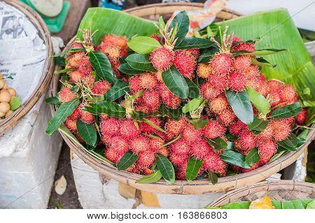 Bunch Of Rambutan In The Wicker Basket On The Vietnamese Market