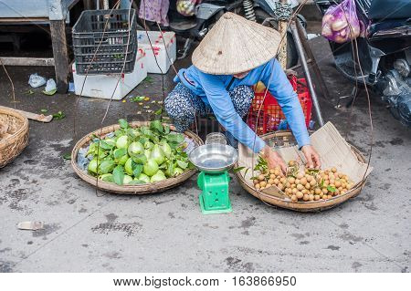 Vietnamese Woman Selling Goods In The Market