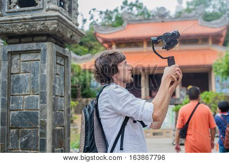 Man Videographer Shoots Video In The Electronic Stabilizer, Steadycam. Digital Technology Concept. D