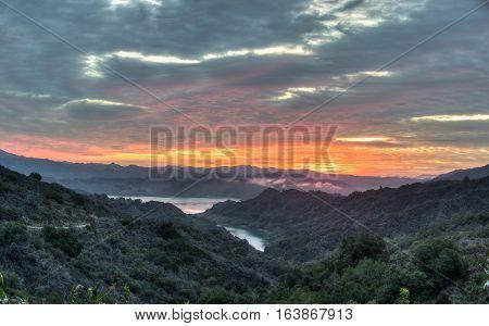 Lake Casitas glowing under sunrise cirrocumulus clouds.