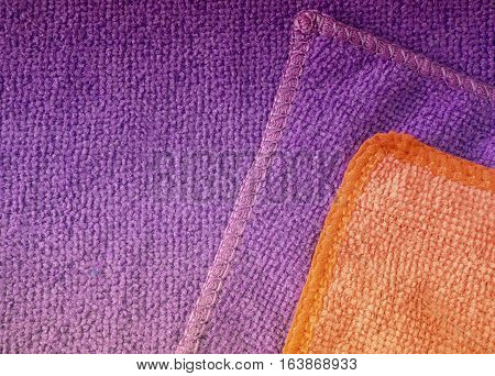 Violet and red microfiber cleaning cloth surface texture background