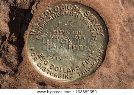 Survey marker at the top of Observation Point in Zion National Park in Utah USA.