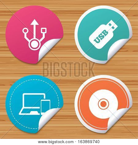 Round stickers or website banners. Usb flash drive icons. Notebook or Laptop pc symbols. Smartphone device. CD or DVD sign. Compact disc. Circle badges with bended corner. Vector