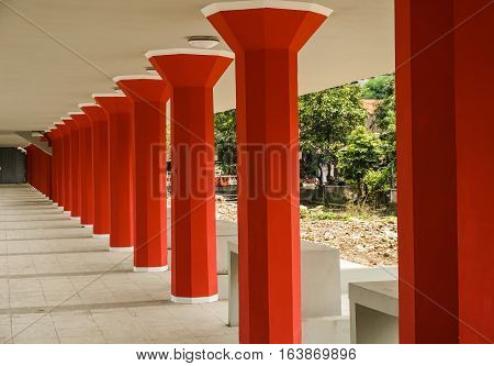 red pillars in a row photo taken in Semarang Indonesia java