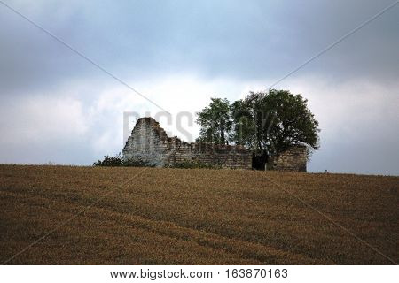 an old disused stone barn in farmland