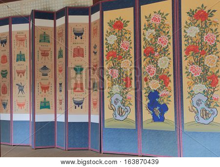 SEOUL SOUTH KOREA - OCTOBER 21, 2016: Traditional Korean art painting at Jogmyo Shrine. Jongmyo shrine is dedicated to the perpetuation of memorial services for deceased kings and queens of the Korea.