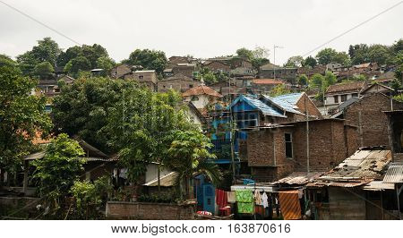 Slums on top of a hill with bush photo taken in Semarang indonesia java