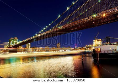 Night New York Brooklyn Bridge New York City Brooklyn bridge and Manhattan skyline night scene over Hudson River