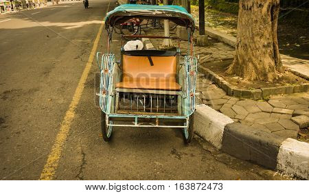 Classic pedicab as on of traditional transportation photo taken in Semarang Indonesia java