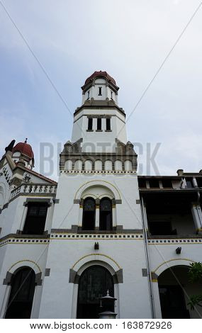 A high tower dome with clear sky as background at Lawang Sewu building photo taken in Semarang Indonesia java