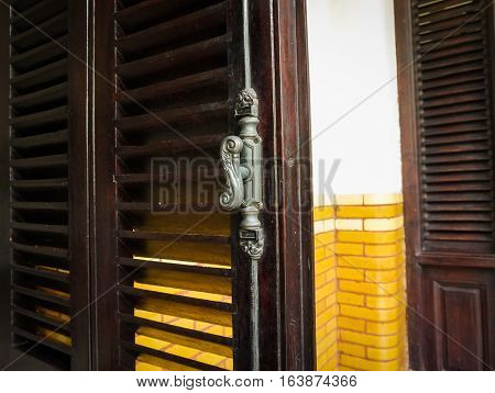Old and classic door handle at Lawang Sewu building photo taken in Semarang Indonesia java