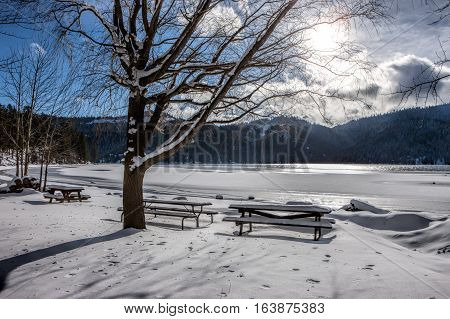 Desolate park by Spirit lake in Idaho during winter.