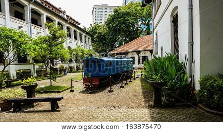 the unused blue old train at Lawang Sewu photo taken in Semarang Indonesia java
