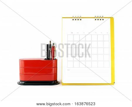 blank yellow calendar with red desk organizer on white background, business planner concept